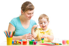 Parent and child plasticine modeling together isolated. On white Royalty Free Stock Image