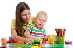 Parent and child plasticine modeling together isolated on white background stock photo