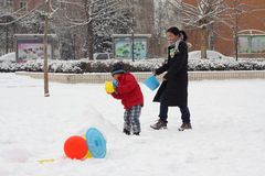 Parent and child playing time in the snow field Royalty Free Stock Photo