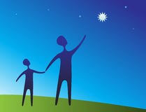 Parent and child pointing at star Stock Photo