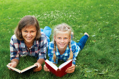 Parent and child reading books together Stock Photos