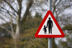 Parent and child road safety sign. Red and white parent and child road safety sign royalty free stock images