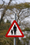 Parent and child road safety sign. Red and white parent and child road safety sign royalty free stock image