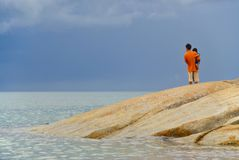 Parent and child by sea stock photos