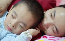 Parent and child sleeping Royalty Free Stock Image