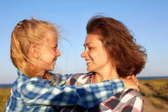 Parent and child smile, enjoy life and looking to camera. Closeup Stock Images