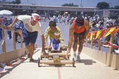 Parent with child in Soap Box Derby Royalty Free Stock Photography