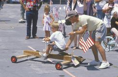Parent with child in Soap Box Derby, Venice, CA Royalty Free Stock Photography