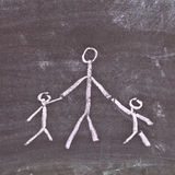 Parent and children. Very simple chalk sketch depicting a single parent with two young children Royalty Free Stock Image