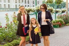 Parent and children on the way to school. Outdoor portrait of a parent and children on the way to school Royalty Free Stock Images