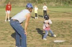 Parent coaching girl Stock Photo