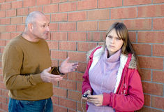 Parent conversation with child. Father is explaining his teenage daughter to listen to him. Parent conversation with child Stock Photo