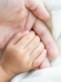Parent and daughter holding hand Stock Image