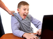 Parent dragging Son from Laptop Stock Photography