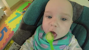 Parent feed newborn baby with spoon and potato mash in it. 4K stock video