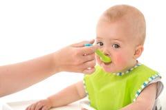Parent feeding infant child stock photo