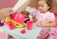 Parent or Friend Playing with Kids at Home: Toddler Tea Party Stock Image