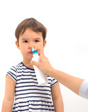 Parent of a girl applies a nasal spray isolated Stock Photography