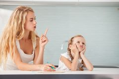 Parent helps the child to do homework royalty free stock photo