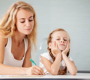 Parent helps the child to do homework Stock Photography