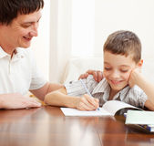 Parent helps his child. Father helping son do homework. Parent helps his child Royalty Free Stock Photos
