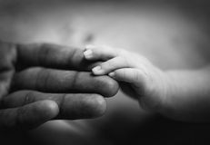 Parent holding newborn baby hand. Family  concept. black and whtie Royalty Free Stock Images