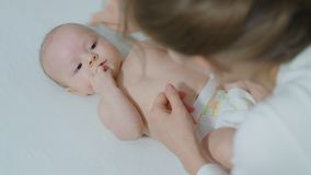 Parent Holding Newborns Hand. Royalty Free Stock Images