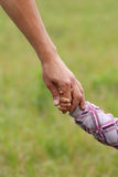 Parent holds the hand of a  child Royalty Free Stock Photo