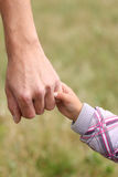 Parent holds the hand of a  child Royalty Free Stock Photography