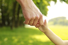 Parent holds the hand of a small child Royalty Free Stock Images