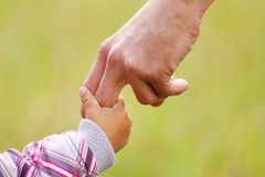 Parent holds the hand of a small child Royalty Free Stock Photos