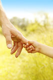 Parent holds the hand of a small child. A parent holds the hand of a small child royalty free stock photos
