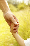 Parent holds the hand of a small child Royalty Free Stock Photo