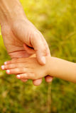 Parent holds the hand of a small child Royalty Free Stock Image