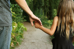 Parent holds the hand of a small child. The parent holds the hand of a small child Royalty Free Stock Photo