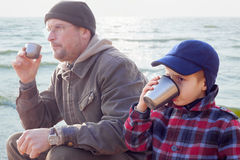 Parent kid together drink tea coffee nature outdoor. Season Stock Photography