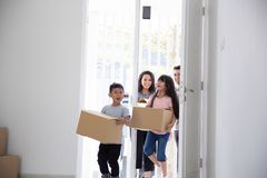 Parent and kids with cardboard box. moving to new house. Portrait of parent and kids with cardboard box. moving to new house concept Stock Image