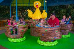 Parent and Kids enjoying Big Bird`s Twirl `N` Whirl attraction at Seaworld in International Drive area  2. Orlando, Florida. April 7, 2019. Parent and Kids royalty free stock images