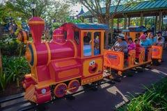 Parent and Kids enjoying colorfur Elmo`s Choo Choo Train at Seaworld in International Drive area  3. Orlando, Florida. April 7, 2019. Parent and Kids enjoying royalty free stock image
