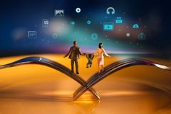 Parent,Kids and New Technology Growing together Concept. Happy Modern Family. Miniature of Father, Mother and Son Balancing body stock photography