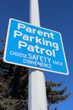 Parent Parking Patrol Sign Against Tree and Blue Sky Royalty Free Stock Images