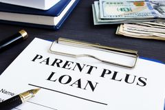 Parent plus loan form and documents in office. Parent plus loan form and documents in the office royalty free stock photo