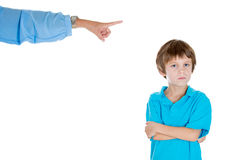 Parent pointing at a disobedient child