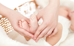 Parent's hands keeping newborn baby's feet Royalty Free Stock Image