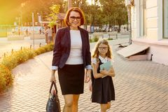 The parent takes the child to school. Urban background Stock Images