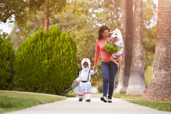 Parent Taking Children Trick Or Treating At Halloween Stock Photography