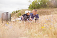 Parent talking child nature lying grass  meadow Stock Photo
