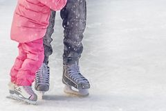 Parent teaches child. To skate on the rink stock photos