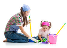 Parent teaches daughter child cleaning room Stock Photo