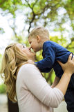Parent touching noses with her son and smiling Stock Photography